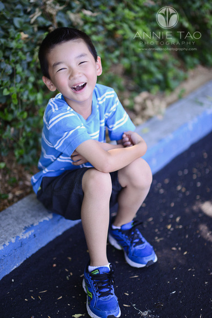 East-Bay-lifestyle-children-photography-young-laughing-boy-sitting-with-arms-crossed