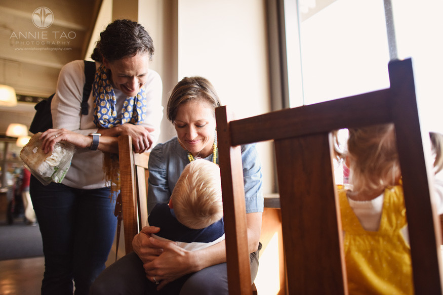 San-Francisco-lifestyle-family-photography-parents-smiing-at-child-in-lap-by-window