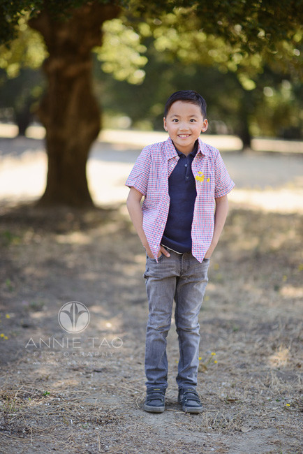 Bay-Area-lifestyle-children-photography-young-boy-stretching-smiling-with-flower