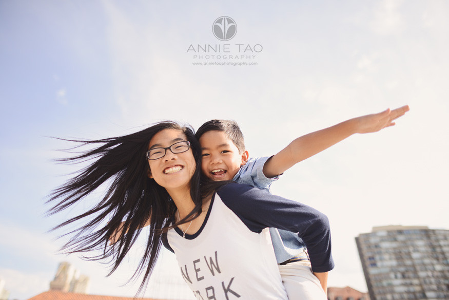 San-Francisco-lifestyle-children-photography-older-sister-giving-brother-an-airplane-ride