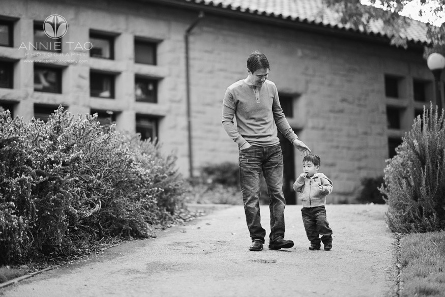 Bay-Area-Palo-Alto-lifestyle-family-photography-dad-walking-with-toddler-boy-who-is-sucking-on-lollypop-BxW