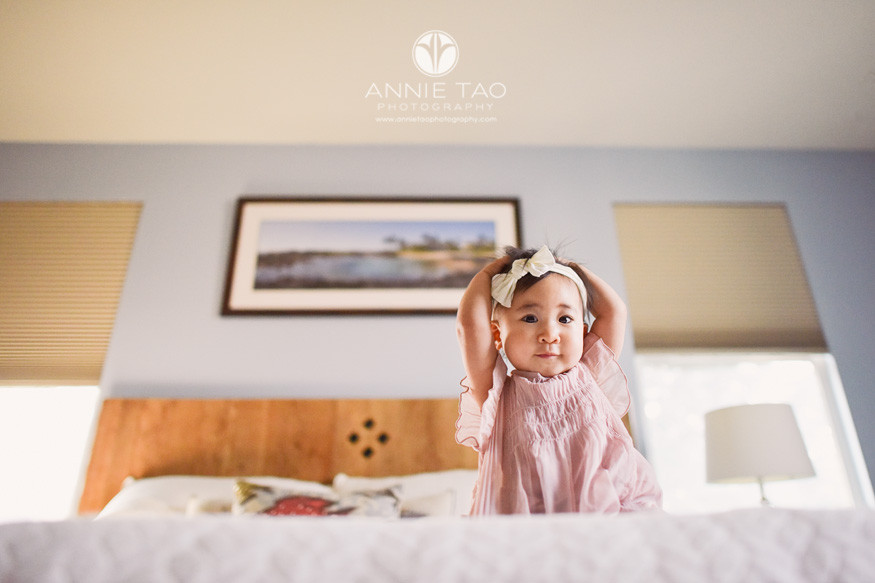 South-Bay-lifestyle-baby-photography-baby-girl-in-pink-sitting-on-bed