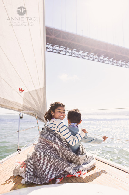San-Francisco-lifestyle-children-photography-young-girl-with-arms-around-little-brother-in-front-of-boat-sailing-bay