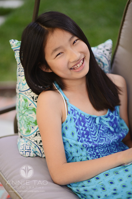 East-Bay-lifestyle-preteen-photography-girl-smiling-on-bench-swing