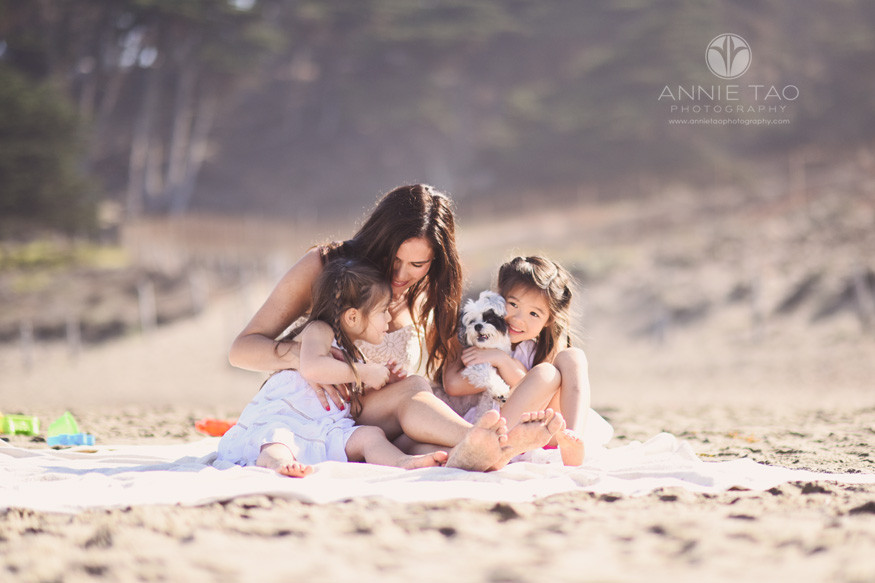 San-Francisco-lifestyle-family-beach-photography-mother-snuggling-daughters-and-furbaby-at-beach