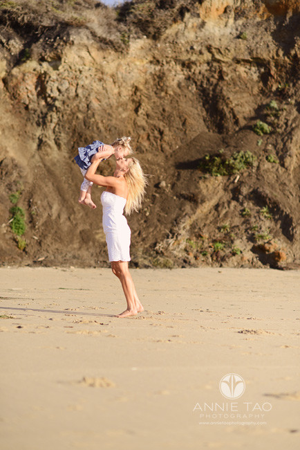 Bay-Area-Half-Moon-Bay-lifestyle-couple-photography-mother-lifting-up-toddler-girl-and-kissing-her