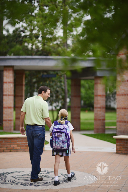 Commercial-education-photography-father-holding-daughters-hand-walking-to-school