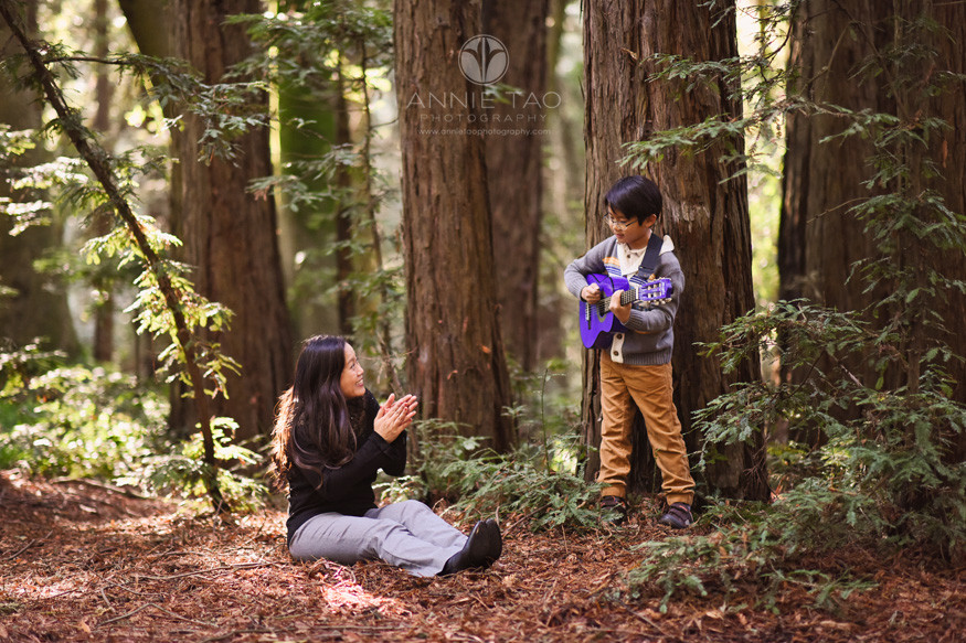 East-Bay-lifestyle-family-photography-mother-applauding-after-sons-guitar-performance-in-forest