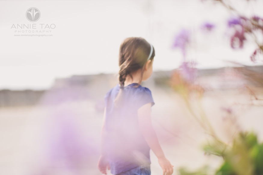 San-Francisco-lifestyle-children-photography-young-girl-walking-behind-purple-flowers