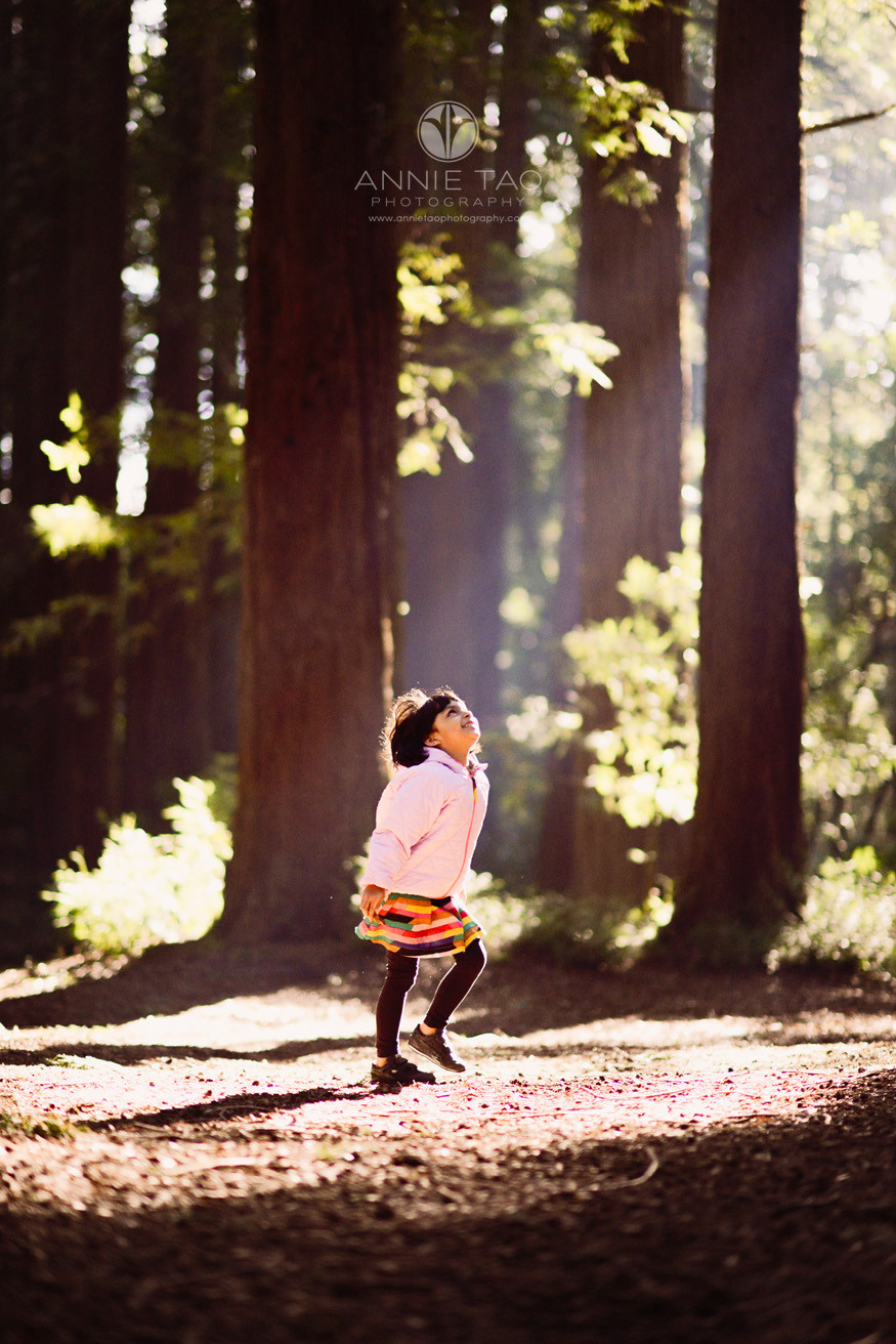 east-bay-lifestyle-children-photography-young-girl-looking-towards-the-light-in-woods-lg