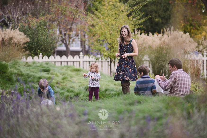 Bay-Area-Palo-Alto-lifestyle-family-photography-woman-watching-her-family-play-in-front-yard