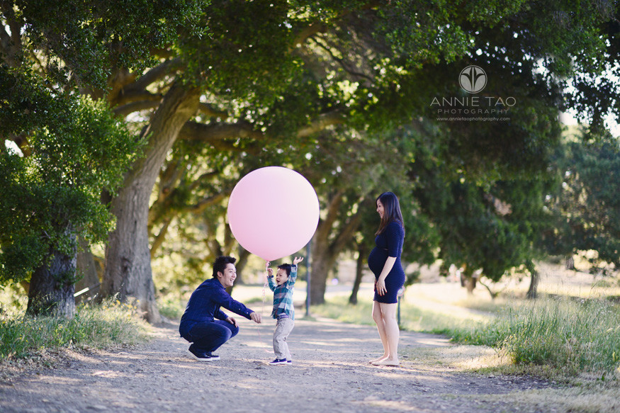 Bay-Area-lifestyle-family-photography-parents-playing-with-toddler-son-with-giant-pink-balloon