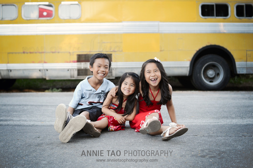 East-Bay-lifestyle-family-photography-three-siblings-sitting-in-the-middle-of-the-road