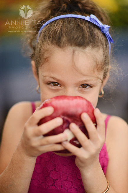 East-Bay-Commercial-Photography-young-girl-holding-a-red-onion-at-Berkeley-farmers-market