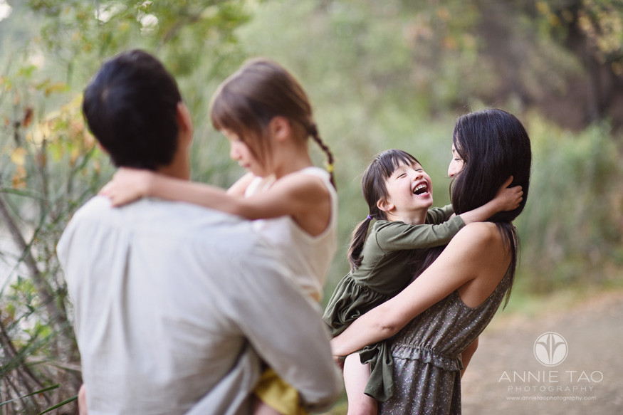 Bay-Area-lifestyle-family-photography-young-girl-laughing-while-mother-holds-her