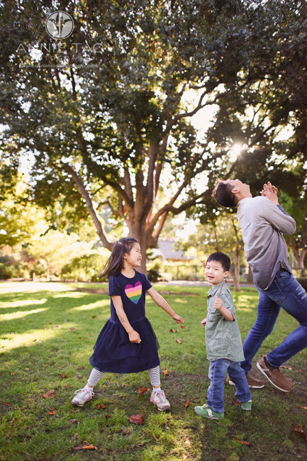 Bay-Area-lifestyle-family-photography-father-cracking-up-after-dancing-with-kids-in-park