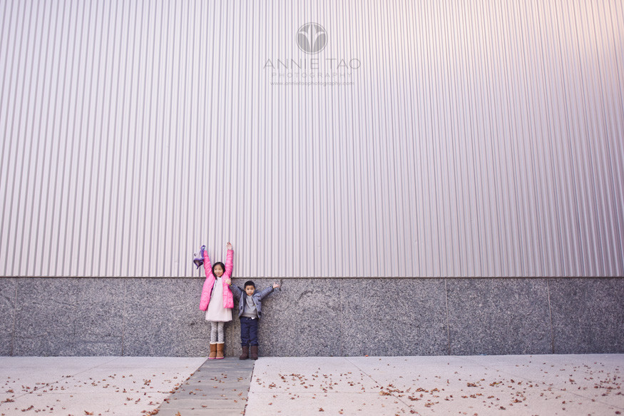 San-Francisco-lifestyle-children-photography-two-tiny-children-standing-next-to-one-giant-wall