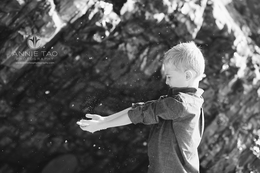 Bay-Area-Half-Moon-Bay-lifestyle-children-photography-boy-touching-waterfall-from-rocks