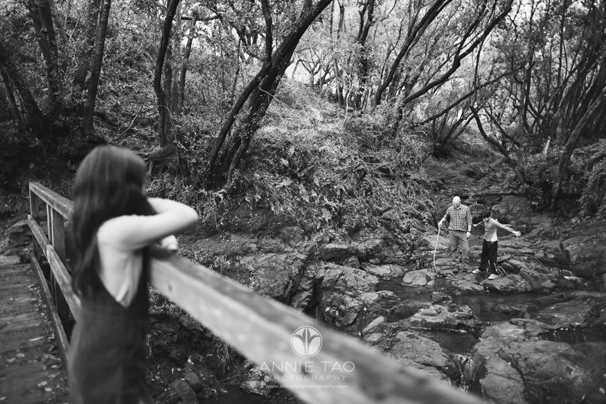 east-bay-berkeley-lifestyle-children-photography-boy-with-dad-by-stream-and-daughter-watches-from-bridge-BxW