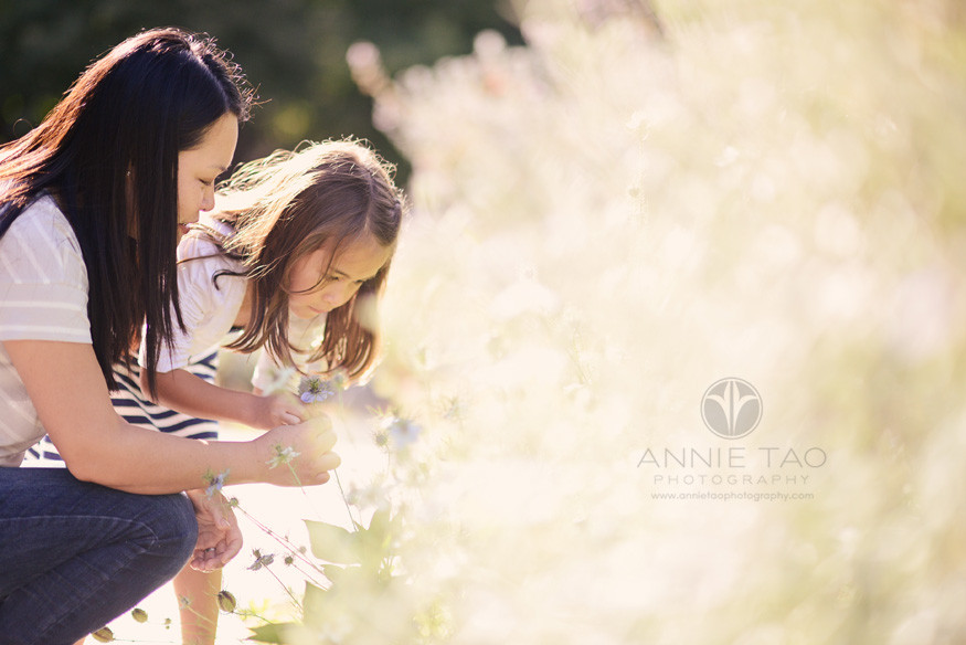 East-Bay-lifestyle-family-photography-mom-and-daughter-picking-a-flower