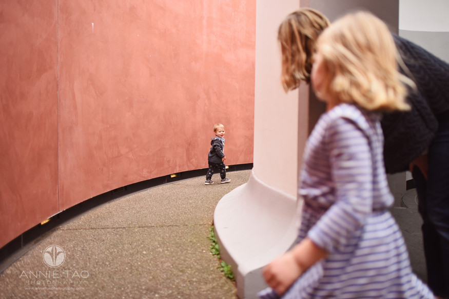 San-Francisco-lifestyle-children-photography-toddler-boy-runs-off-and-looks-back-at-family