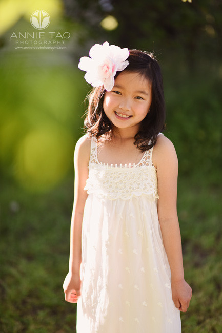 East-Bay-styled-children-photography-smiling-young-girl-with-giant-flower-headpiece