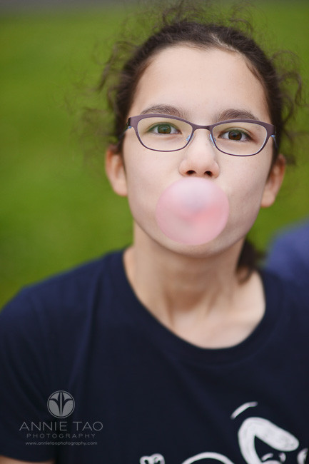 San-Francisco-lifestyle-children-photography-girl-with-glasses-blows-big-bubble