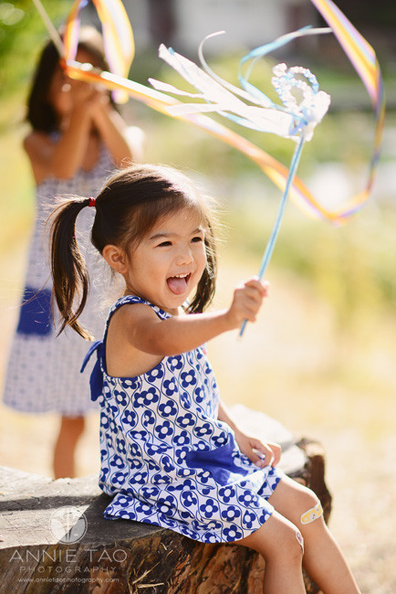 East-Bay-lifestyle-children-photography-toddler-twirling-baton-with-glee