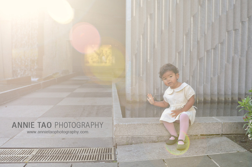 San-Francisco-lifestyle-family-photography-toddler-sitting-by-fountain-with-flare