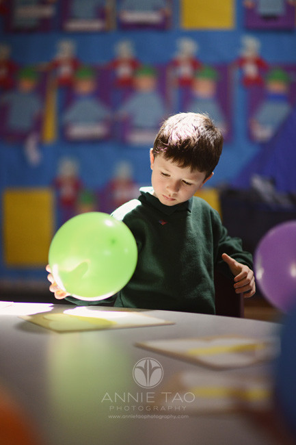 San-Francisco-Bay-Area-commercial-photography-boy-holding-green-balloon-for-science-project