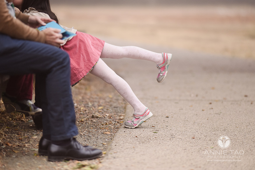 San-Francisco-Bay-Area-lifestyle-children-photography-little-girls-leg-playfully-sticking-up-while-leaning-into-family