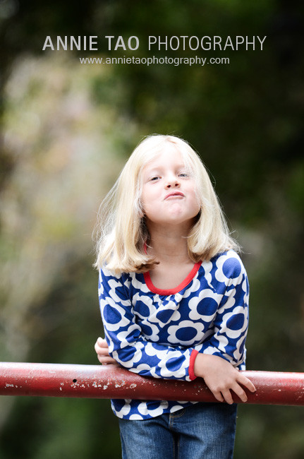 East-Bay-lifestyle-family-photography-girl-leaning-on-gate-funny-face