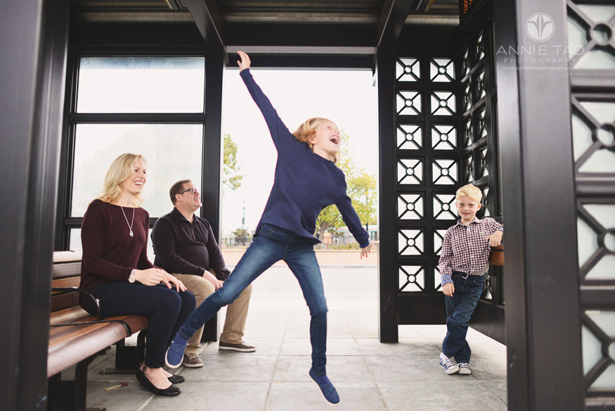 Bay-Area-lifestyle-family-photography-family-at-bus-stop-girl-leaping