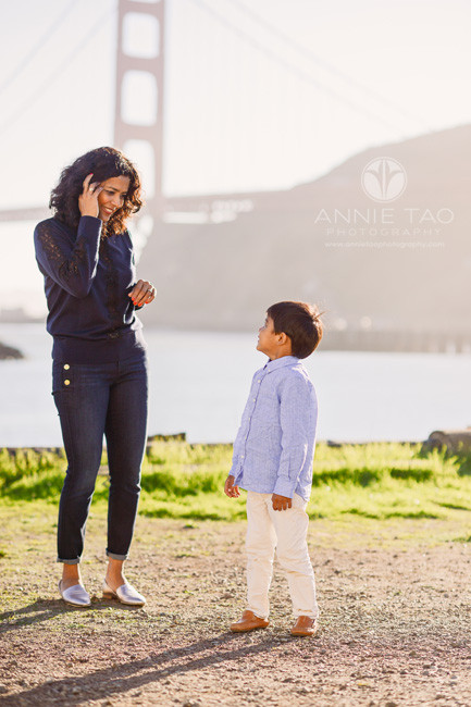 san-francisco-lifestyle-family-photography-son-and-mom-looking-at-each-other-at-sunset-by-bay