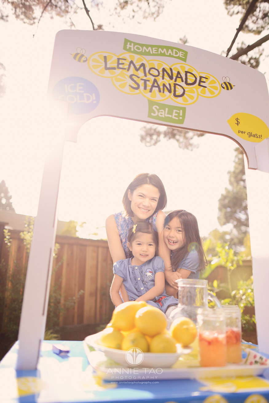 East-Bay-lifestyle-family-photography-mother-and-daughters-with-lemonade-stand-and-sunflare-Lg