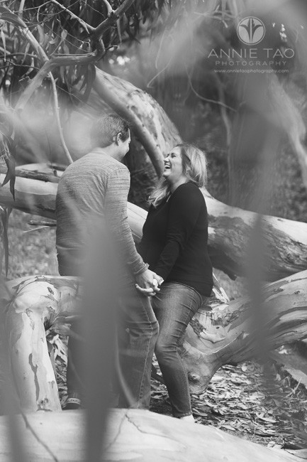 San-Francisco-engagement-photography-couple-laughing-on-fallen-tree-BxW