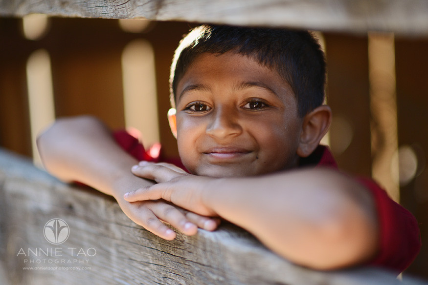 East-Bay-lifestyle-children-photography-boy-in-red-leaning-on-barn-door