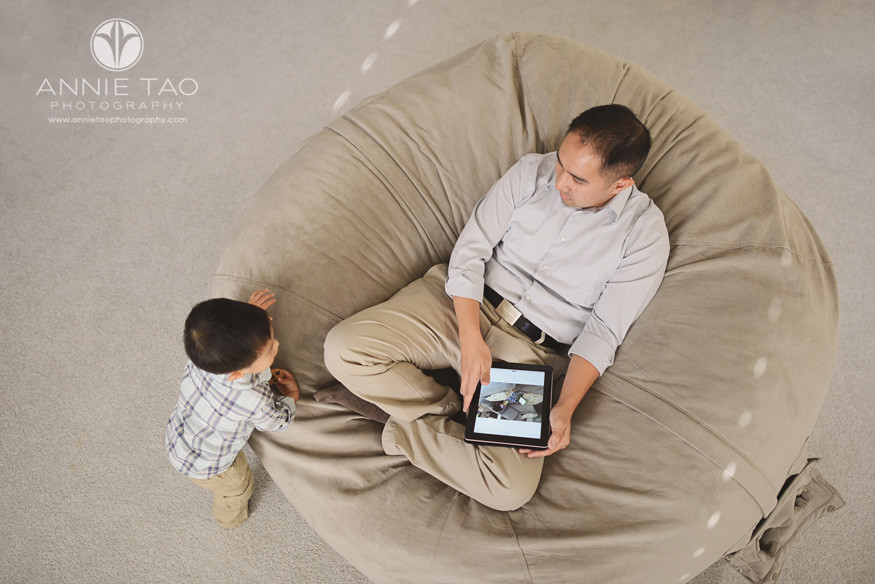 South-Bay-lifestyle-family-photography-son-next-to-father-with-iPad-in-giant-beanbag