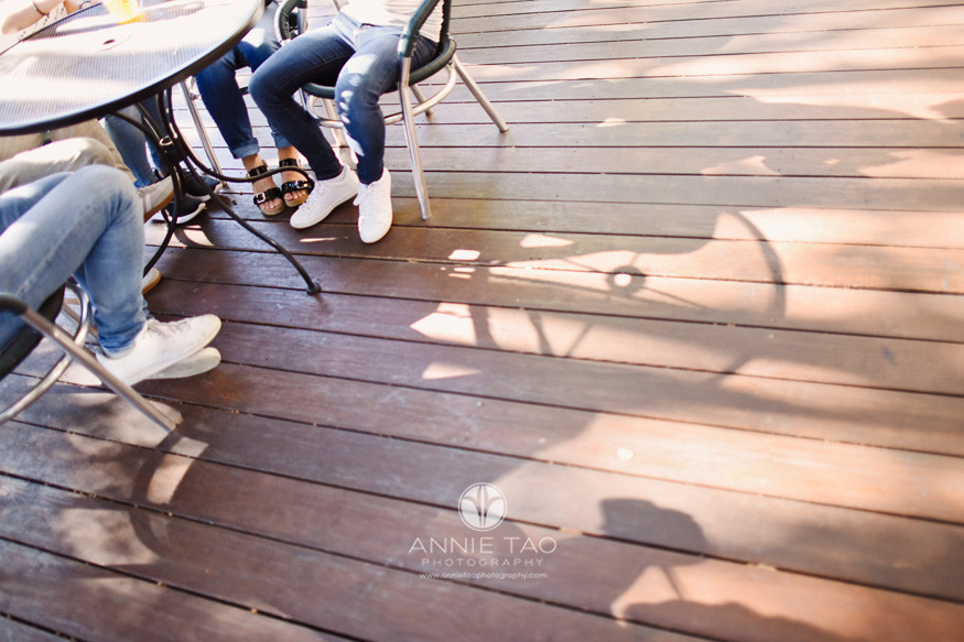 San-Jose-lifestyle-family-photography-family-legs-and-feet-at-table-with-shadow