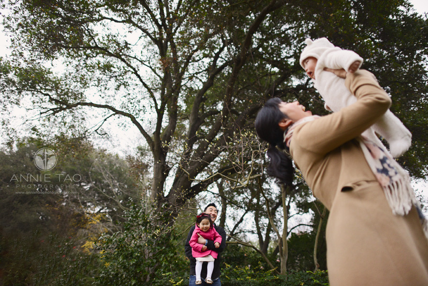 Bay-Area-Palo-Alto-lifestyle-family-photography-father-holding-toddler-and-watching-mom-play-with-baby