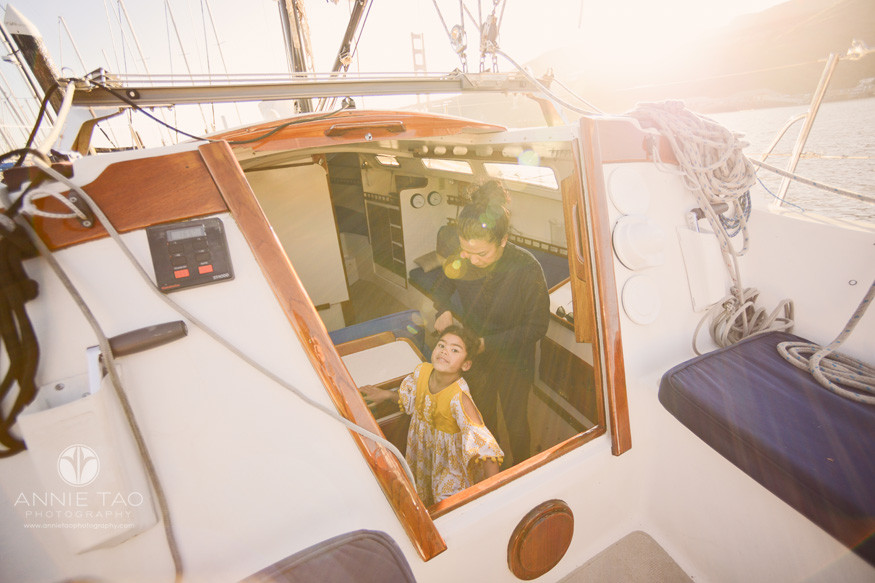 san-francisco-lifestyle-family-photography-mother-fixing-daughters-hair-on-sailboat