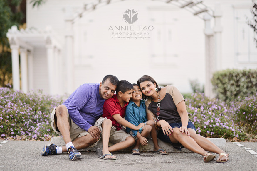 East-Bay-lifestyle-family-photography-family-sitting-in-parking-lot-and-leaning