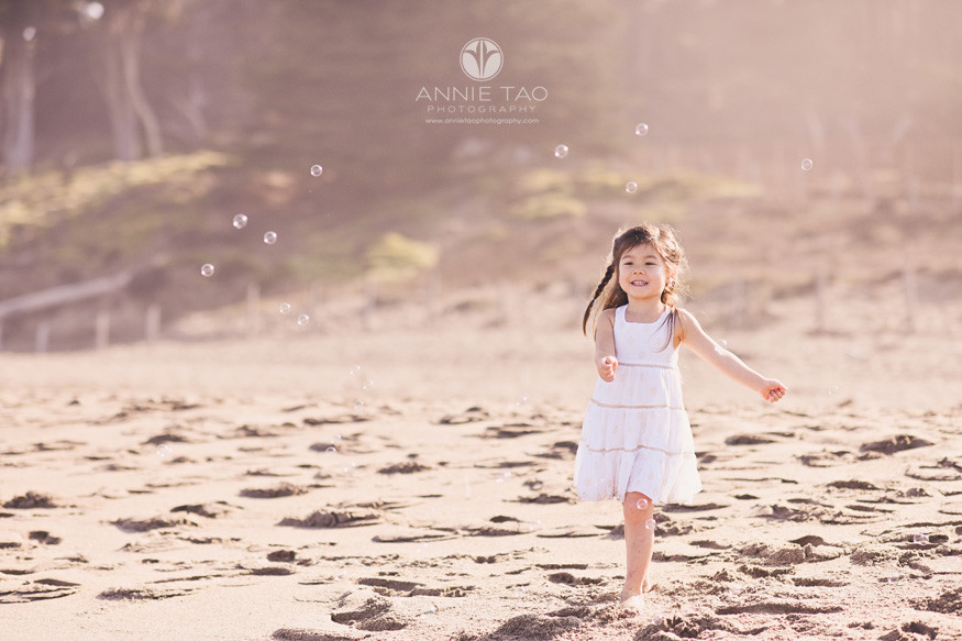 San-Francisco-lifestyle-children-photography-preschool-girl-running-on-beach-towards-bubbles