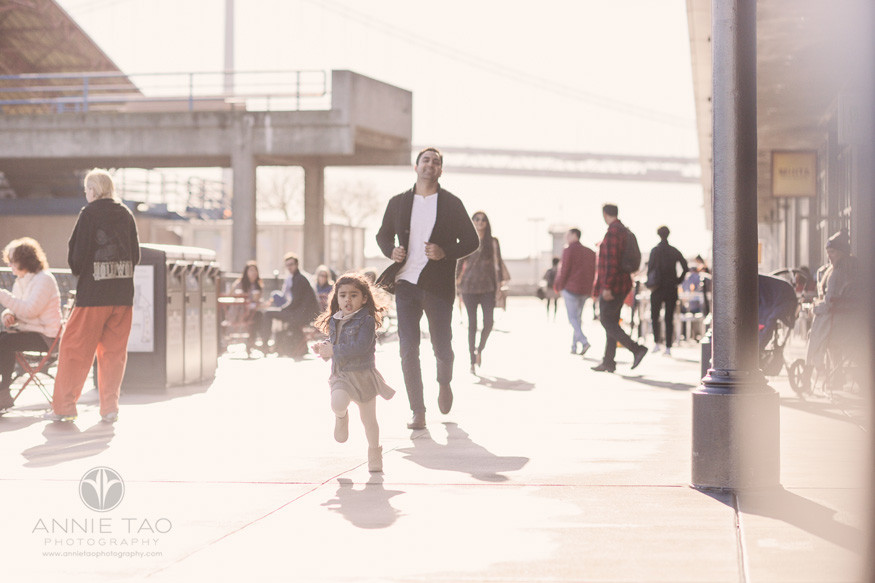 san-francisco-lifestyle-family-photography-father-chasing-runaway-preschool-daughter-at-ferry-plaza