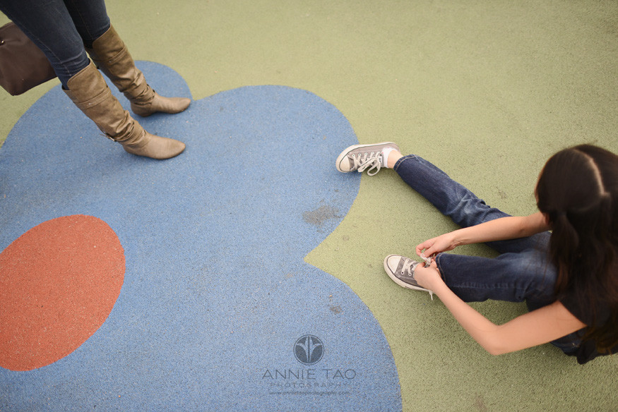 San-Francisco-lifestyle-children-photography-mom-watching-daughter-tying-shoes-topview