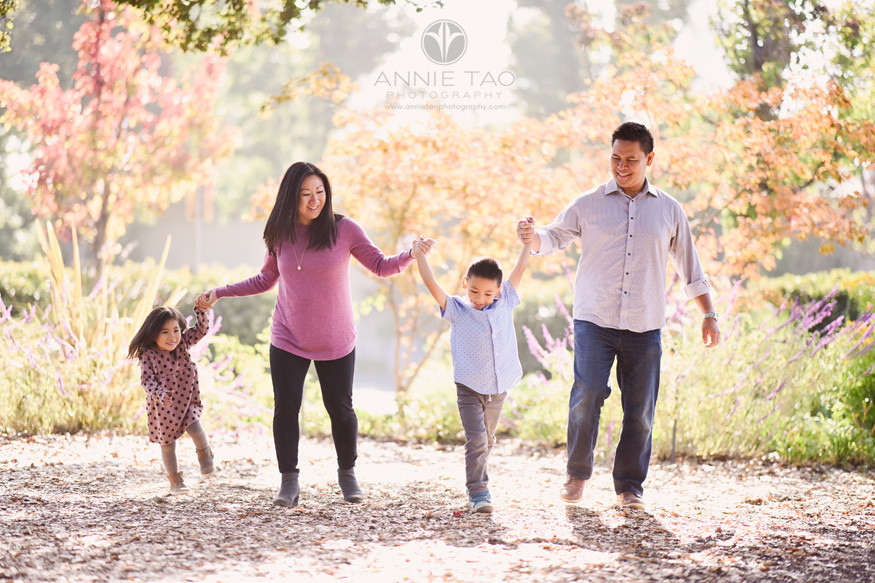 san-francisco-bay-area-lifestyle-family-photography-holding-hands-with-full-sun-in-garden