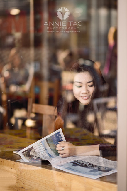 San-Francisco-senior-photography-teen-girl-reading-behind-glass