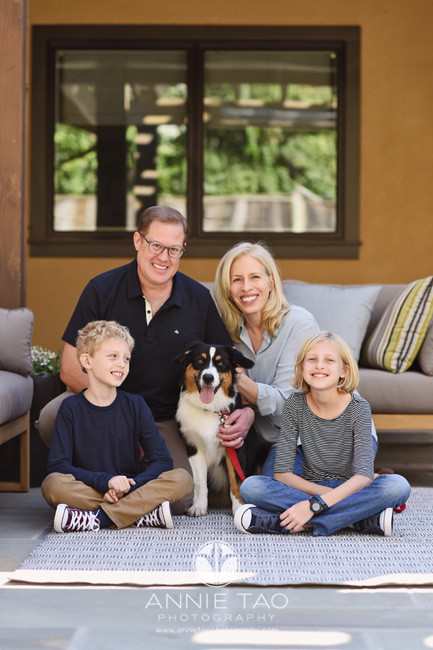 Bay-Area-lifestyle-family-photography-family-sitting-with-puppy-in-backyard