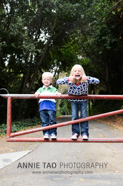 East-Bay-lifestyle-family-photography-kids-making-funny-faces-on-gate