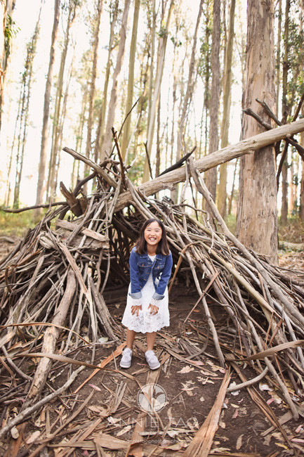 San-Francisco-lifestyle-children-photography-young-girl-laughing-by-stick-teepee